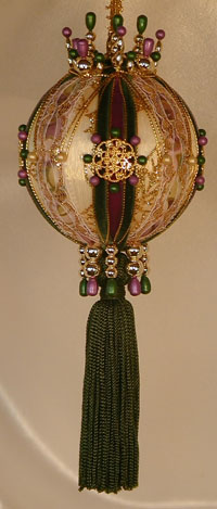 Lush purple and green velvet Victorian Style Christmas Tree ornament with a gold filigree button and Swarovski Crystals