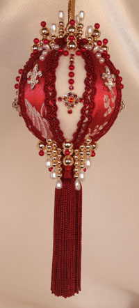 This Victorian Style Ornament is created with the most beautiful shades of red, deep and rich, monochromatic set off with a staggered Fleur De Lis Rhinestone button and elaborately hand set Swarovski Crystals