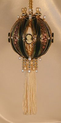 Victorian Ornament with lush tassel, shades of hunter and gold, accented with a beautiful cameo