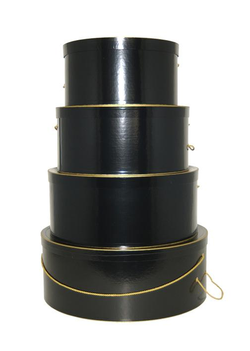 Glossy Black set of hatboxes.  Hat Box set of four sizes Black with Gold Trim