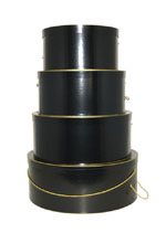 Glossy black hatboxes in a nested set of four trimmed in gold