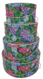 Hydrangea Blooms stand out on this pretty pink and blue floral set of hatboxes
