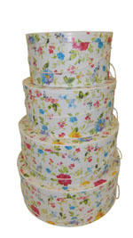 Wild flowers in multi colors of blue rose and daffodil on this Victorian Style set of hatboxes