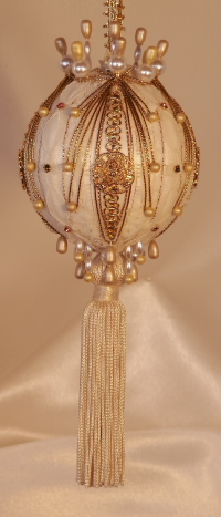 An ivory tassel, velvet and Swarovski Crystals on this collectible, giftable heirloom ornament