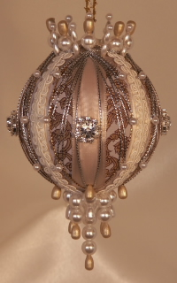 A gold scroll jacquard, rich and textured, silver and gold, rhinestones and lace on on one gorgeous heirloom ornament